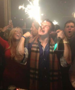 Johnny Manziel partying at a club and holding a bottle of Dom Perignon
