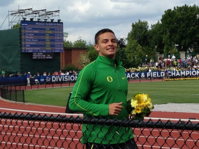Devon Allen smiles during his victory lap after winning the national title in the men's 110 hurdles.