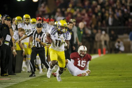 Bralon Addison (11) runs down the sideline after beating one defender.