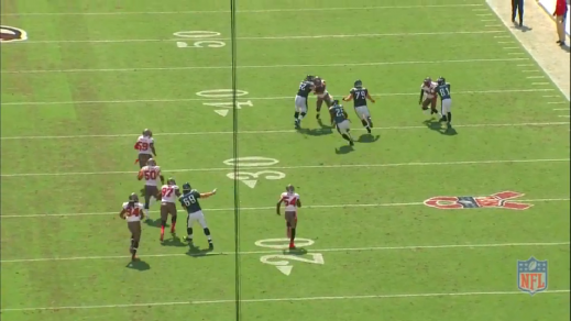 Kelce gets his hands on the defensive back's chest and overwhelms him.