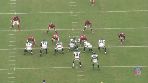 Kelce points at the linebacker, the defender whom he will block on this play.