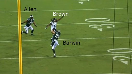 Barwin tips the ball in the air.