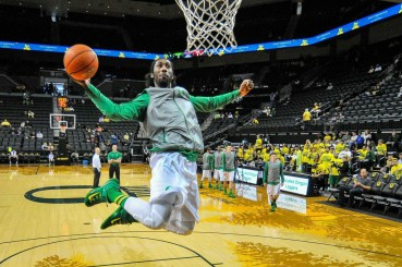 Dwayne Benjamin takes flight during warm-ups against the Utes.