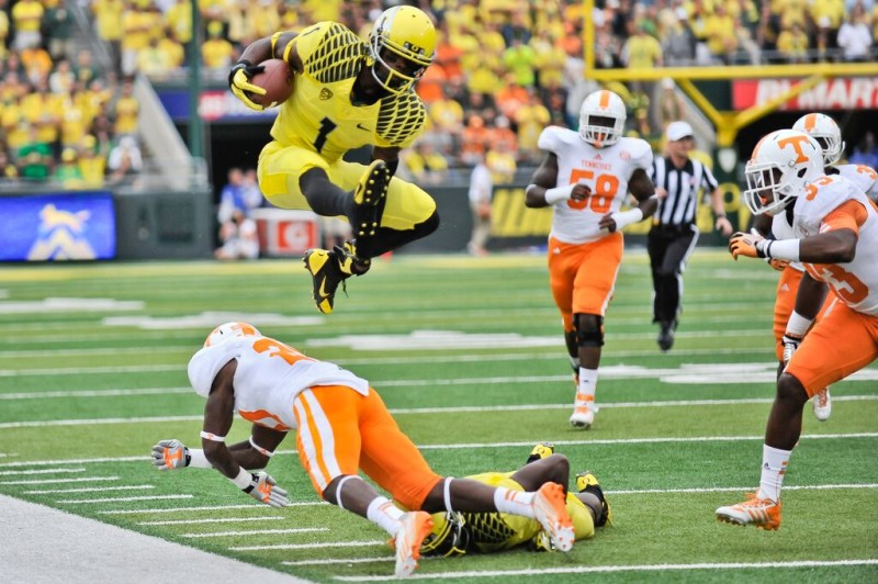 Josh Huff hurdles a defender against Tennessee in 2013.
